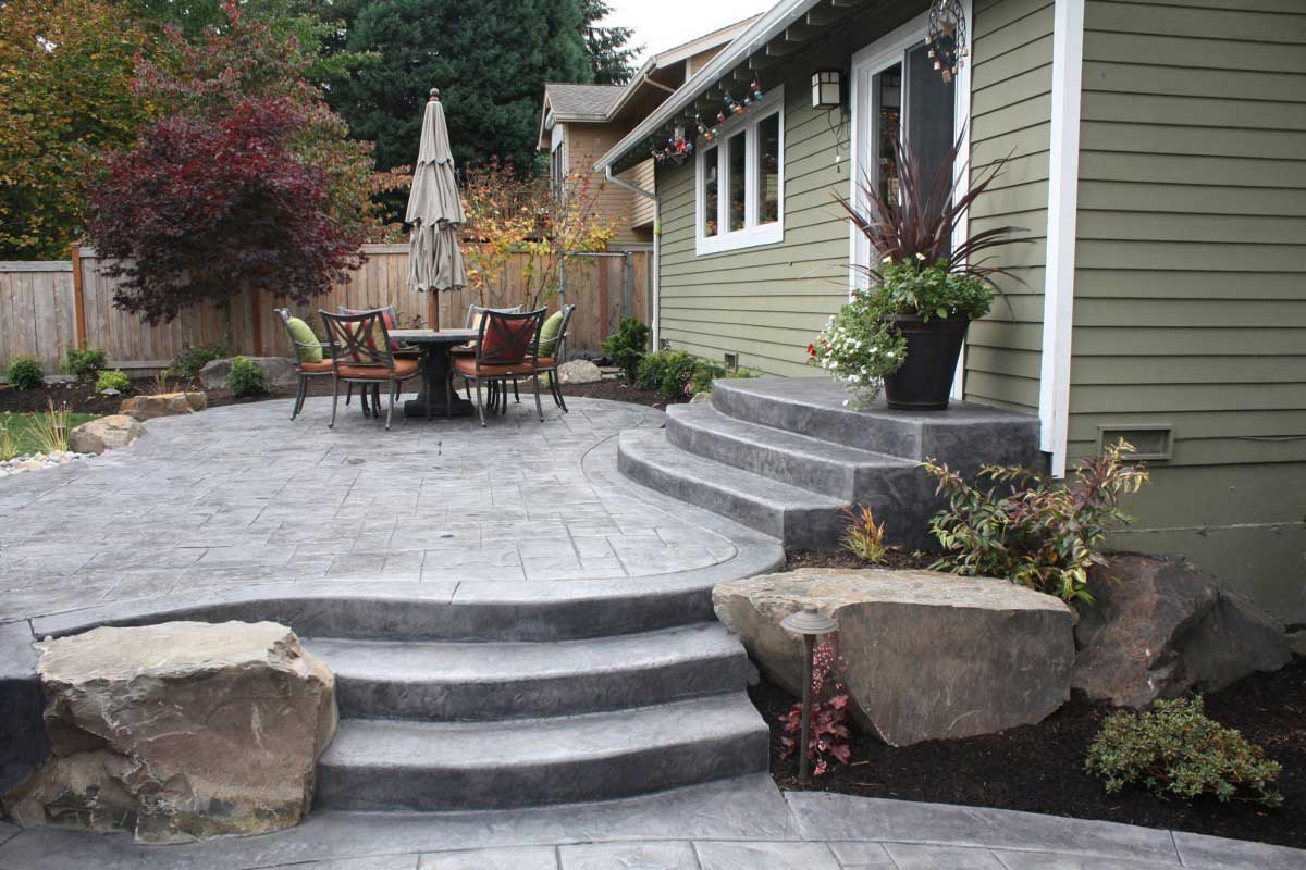 Be Sure To Incorporate Natural Elements Into Your Landscape. Curved Concrete  Patio ...