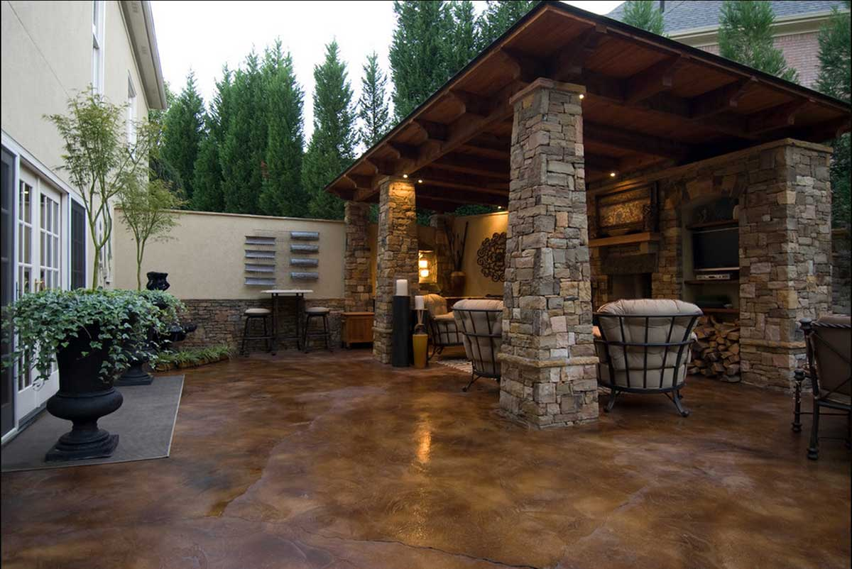 Stained Concrete Patio To Match The House Stone Work.