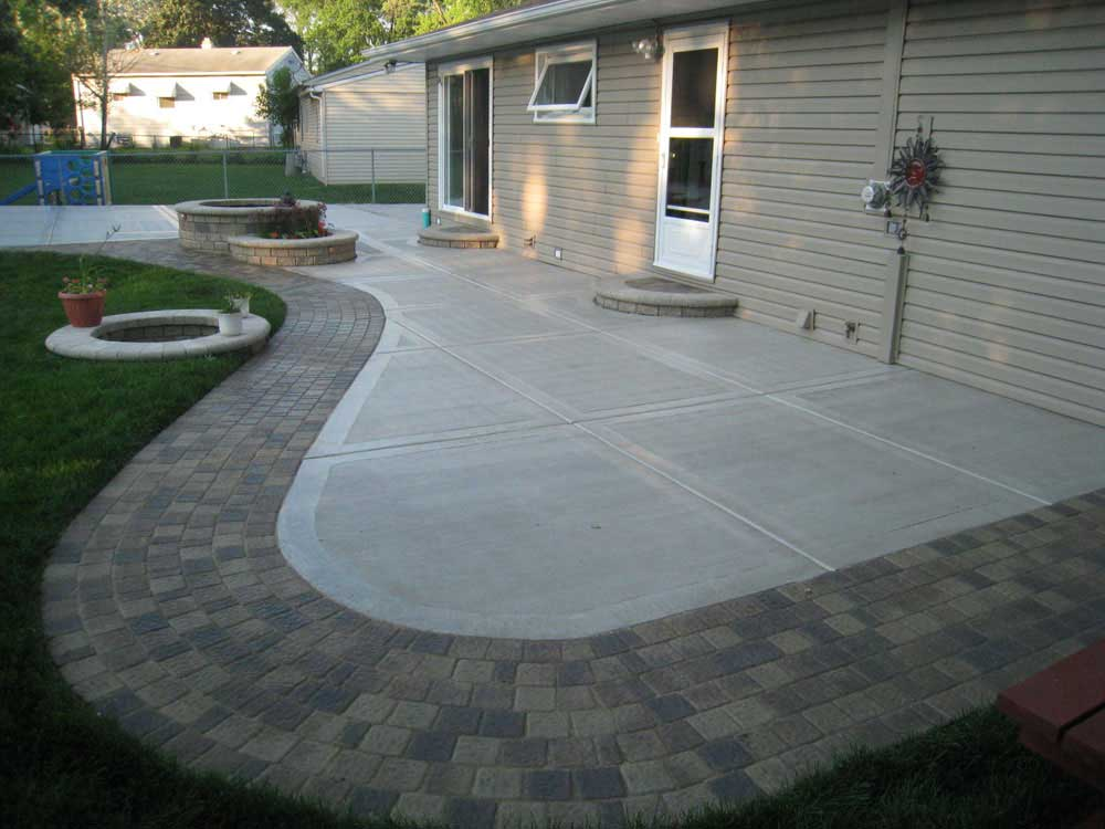 How to build concrete patio in 8 easy steps diy slab against house save money with pavers to dress up a plain concrete patio solutioingenieria Image collections